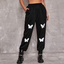 Hose mit Schmetterling Muster und schraegen Taschen