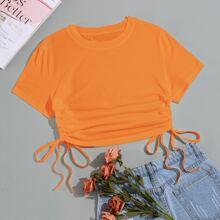 Einfarbiges Crop T-Shirt mit seitlichem Kordelzug