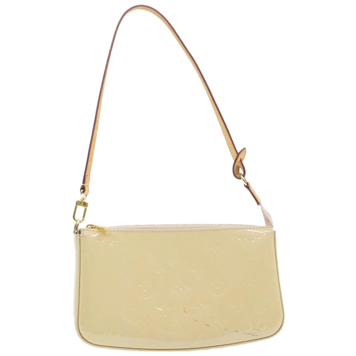 Louis Vuitton - Sac de voyage   pour femme en cuir verni - beige