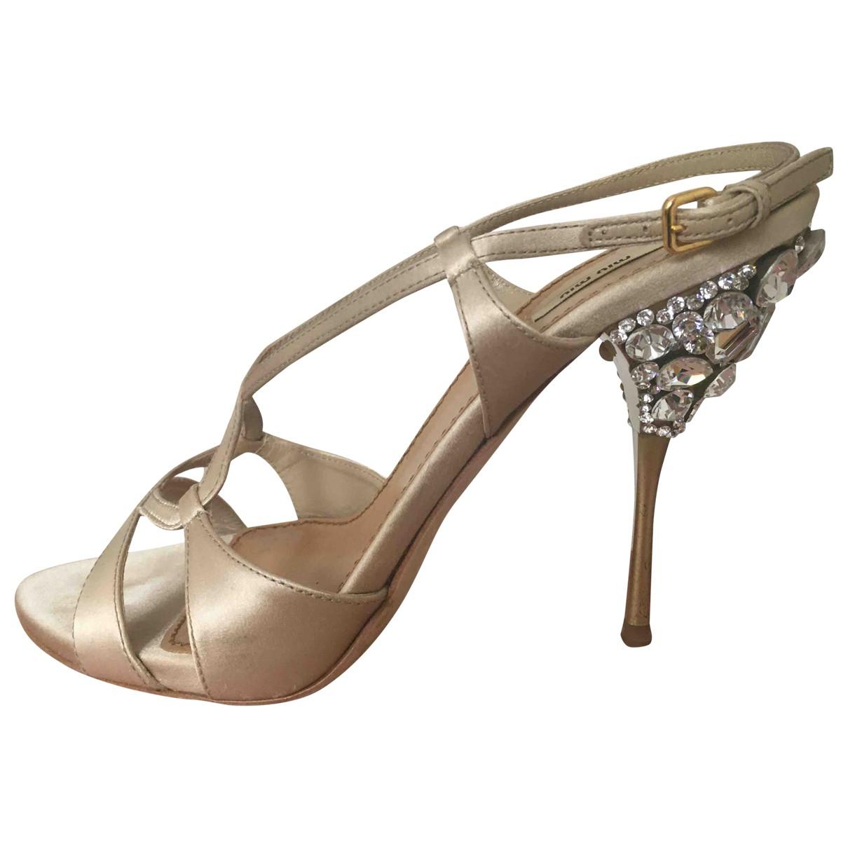 Miu Miu \N Gold Cloth Sandals for Women 38.5 EU