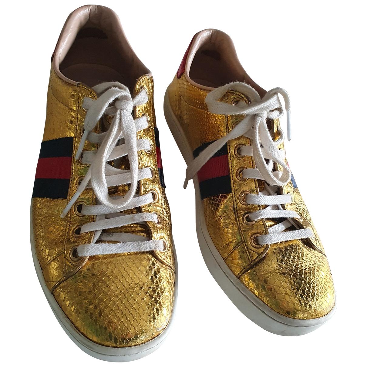 Gucci - Baskets Ace pour femme en python - dore