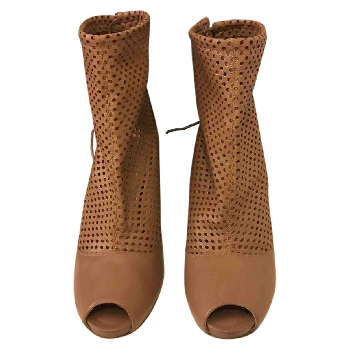 - Boots   pour femme en cuir - camel