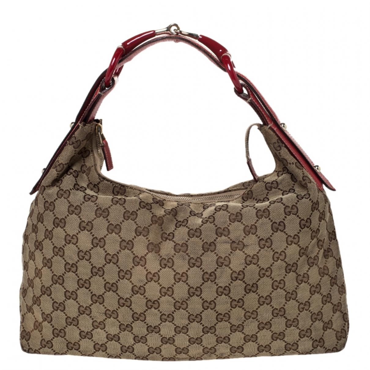 Gucci Hobo Handtasche in  Beige Leder