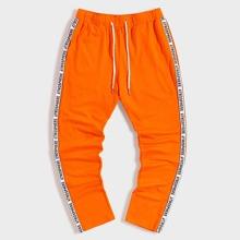 Men Neon Orange Drawstring Waist Letter Tape Sweatpants