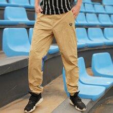 Pantalones ribete panel en contraste con diseño de parche