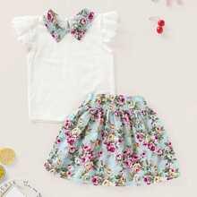Blusa de niñitas de cuello en contraste con falda con estampado floral