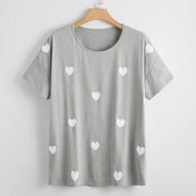T-Shirt mit sehr tief angesetzter Schulterpartie und Herzen Muster