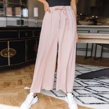 Hose mit Taillenband, Schlitz und breitem Beinschnitt