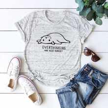 Camiseta de manga corta con texto y dibujo