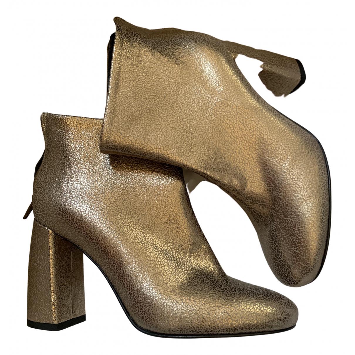 - Boots   pour femme en cuir - dore