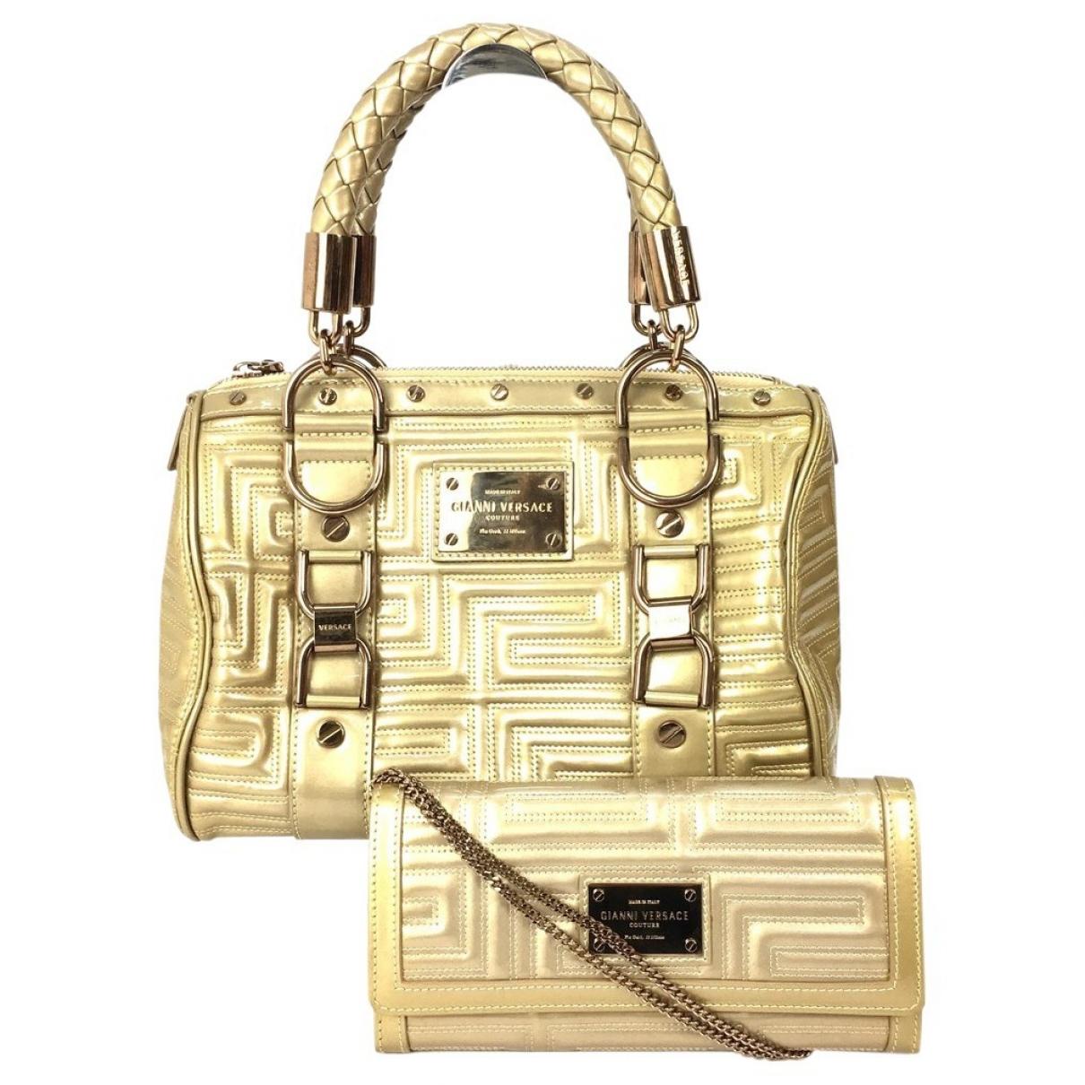 Versace \N Gold Patent leather handbag for Women \N