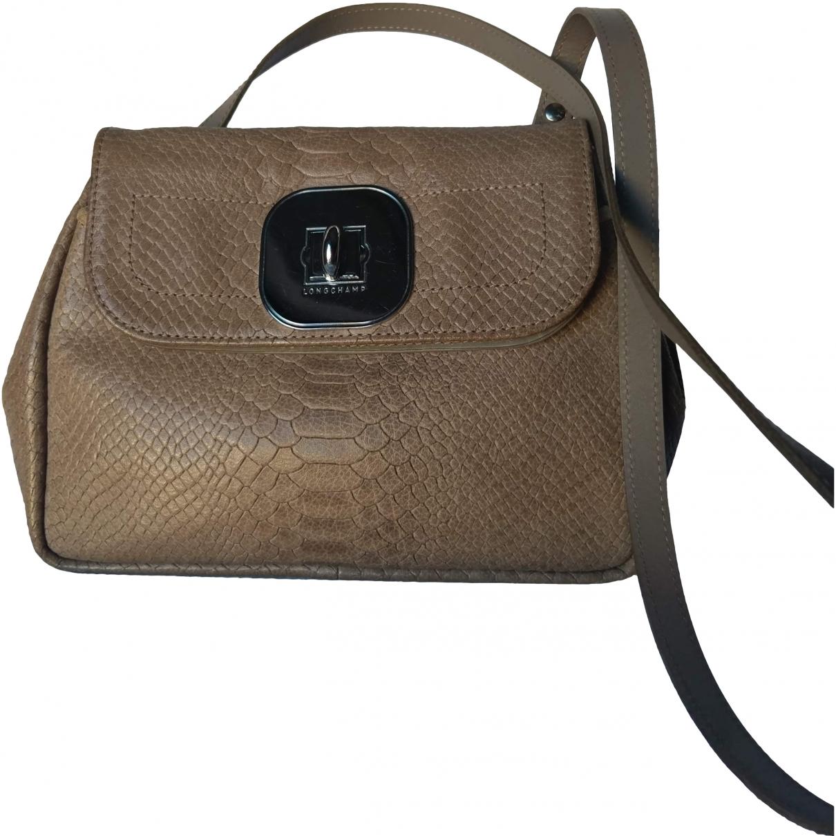 Longchamp \N Beige Leather handbag for Women \N