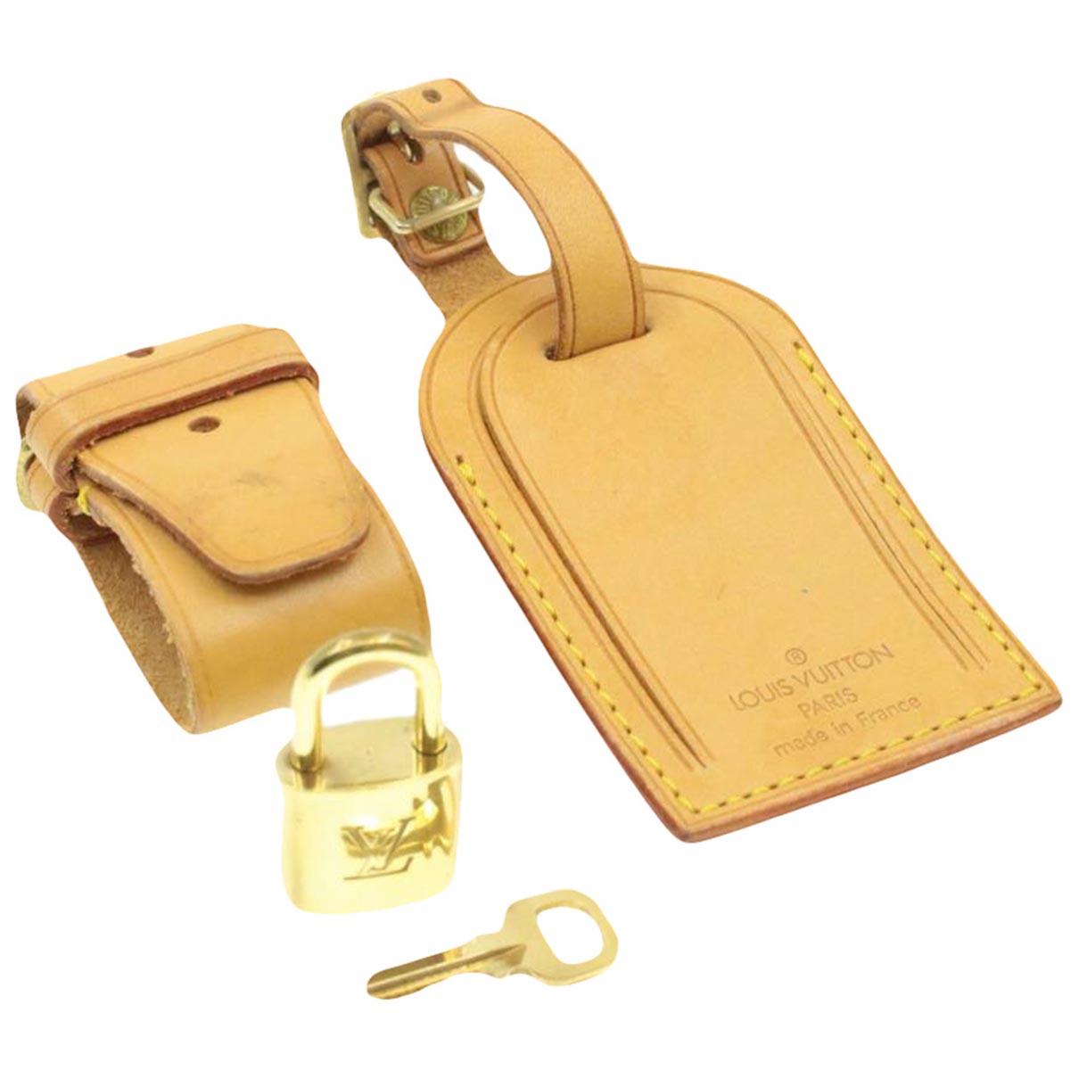 Louis Vuitton \N Taschenschmuck in  Beige Leder