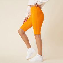 Neon orange Strick Shorts mit breitem Taillenband