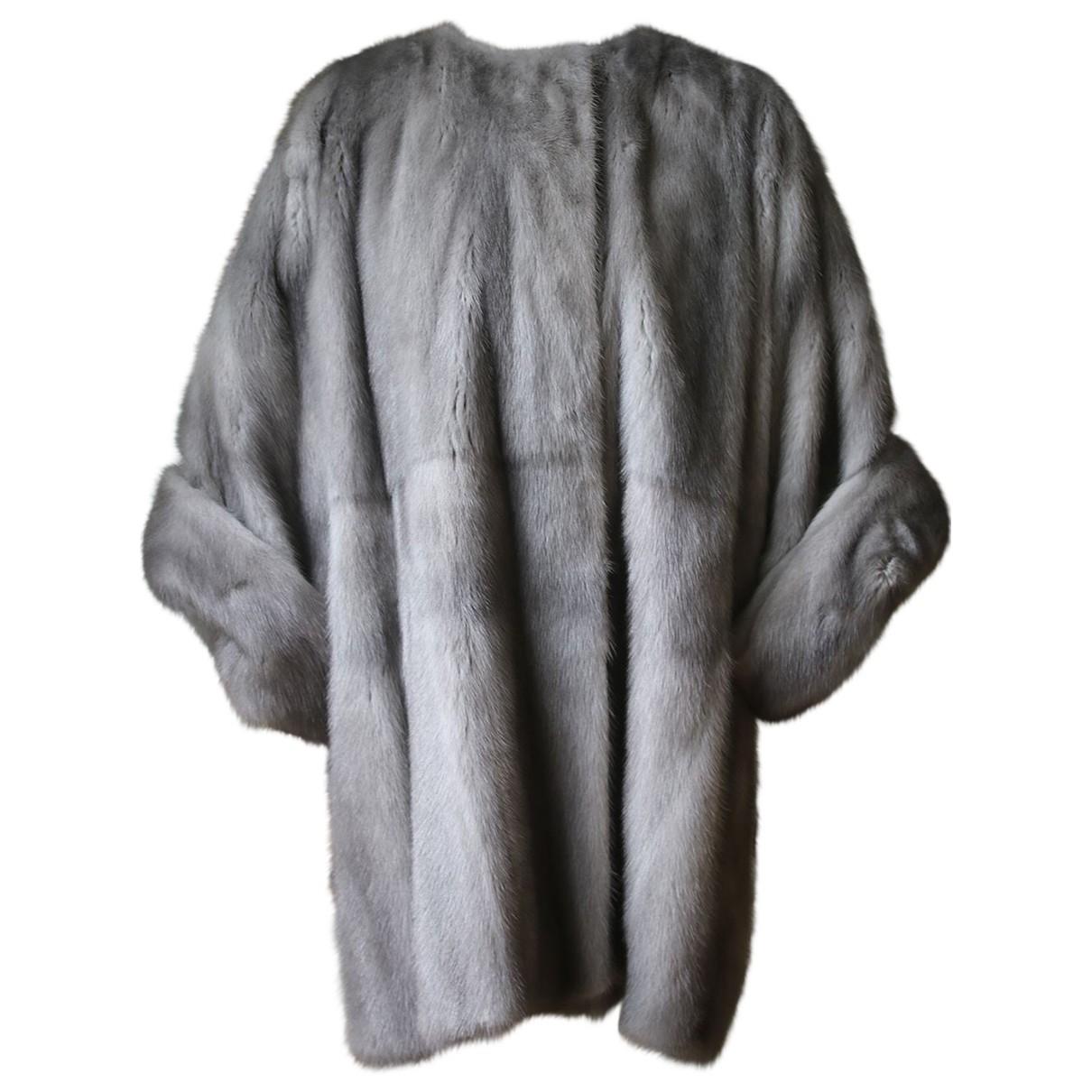 Dolce & Gabbana - Manteau   pour femme en fourrure - gris