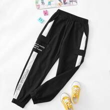 Pantalones con bolsillo lateral con solapa con estampado de slogan