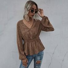 Bluse mit Muster und Schosschen
