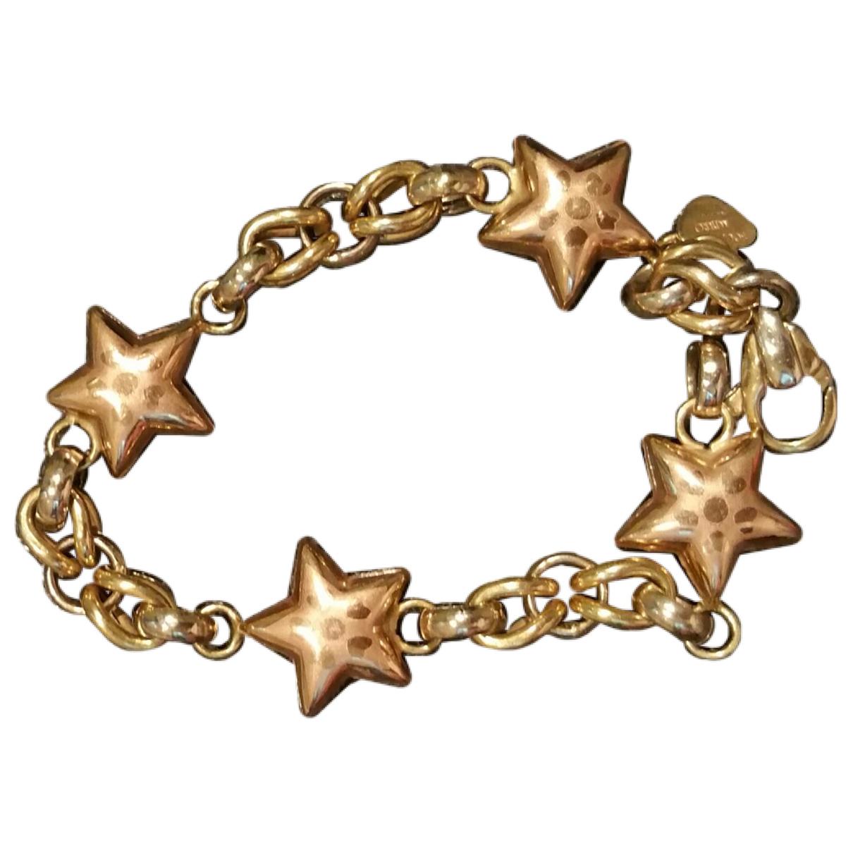 - Bracelet Motifs Etoiles pour femme en or jaune - dore