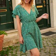 Rueckenfreies A-Linie Kleid mit Bluemchen Muster und Band hinten