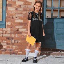 Kleid mit Netzstoff, Rueschenbesatz an Ärmeln und Buchstaben Grafik