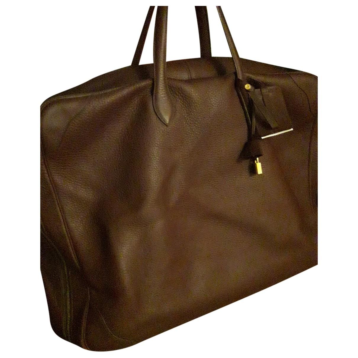 Hermes - Sac de voyage   pour femme en cuir - bordeaux