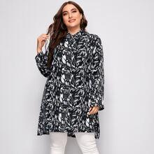 Lange Bluse mit komplettem Muster und abfallendem Saum