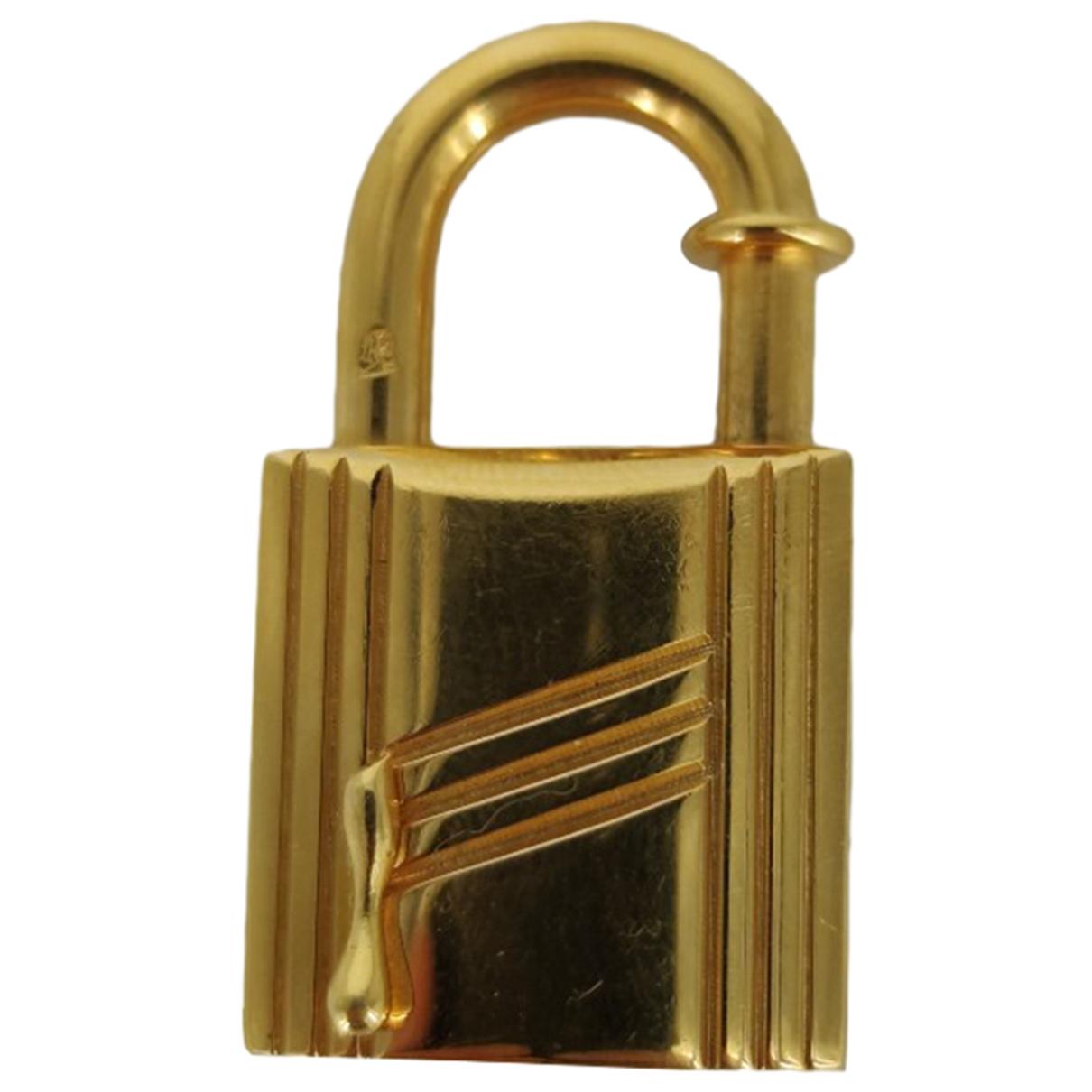 Hermes \N Taschenschmuck in  Gold Metall