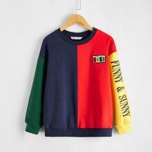 Pullover de color combinado con parche de numero
