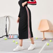 Falda bajo con abertura con cinta lateral de rayas