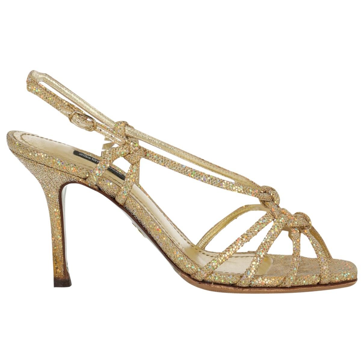 Dolce & Gabbana \N Sandalen in  Gold Mit Pailletten