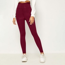 Leggings mit Kreuzgurt hinten und hoher Taille