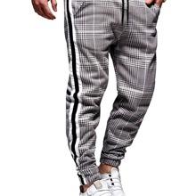 Pantalones de cuadros con cinta lateral de rayas
