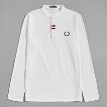 Polo Shirt mit Grafik und Stickereien