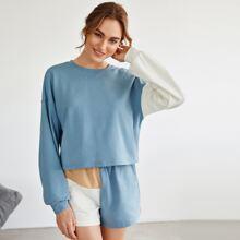 Pullover mit sehr tief angesetzter Schulterpartie und Farbblock & Track Shorts Set