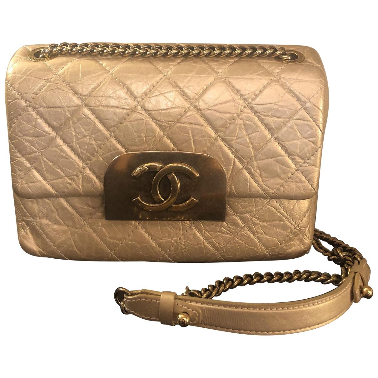 Chanel - Sac a main   pour femme en cuir - dore
