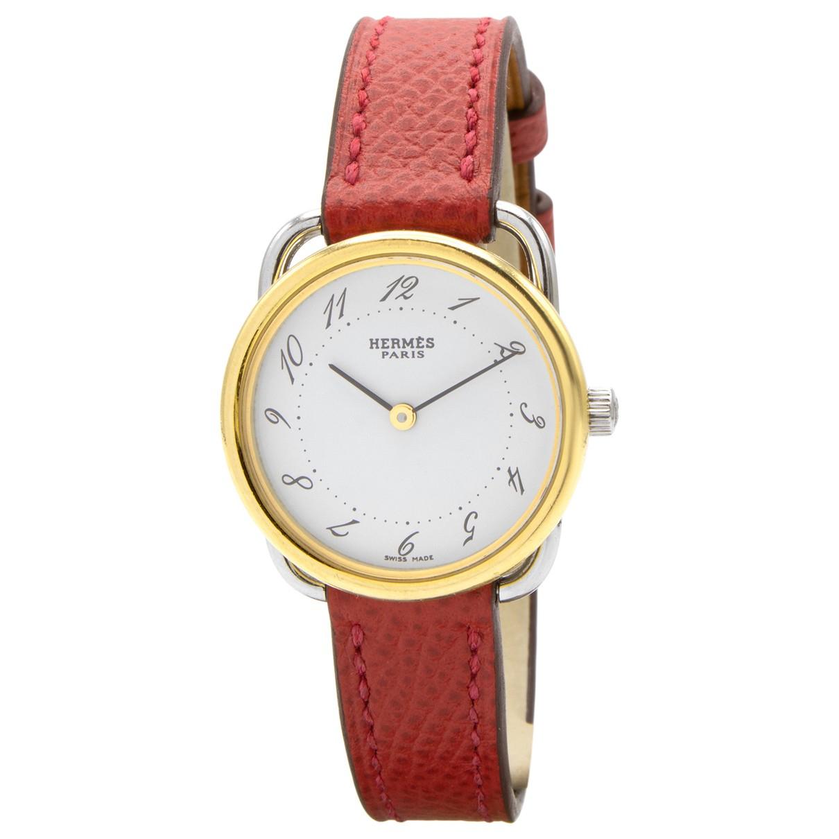 Hermes - Montre Arceau pour femme en plaque or - rouge
