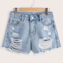 Shorts denim bajo crudo roto