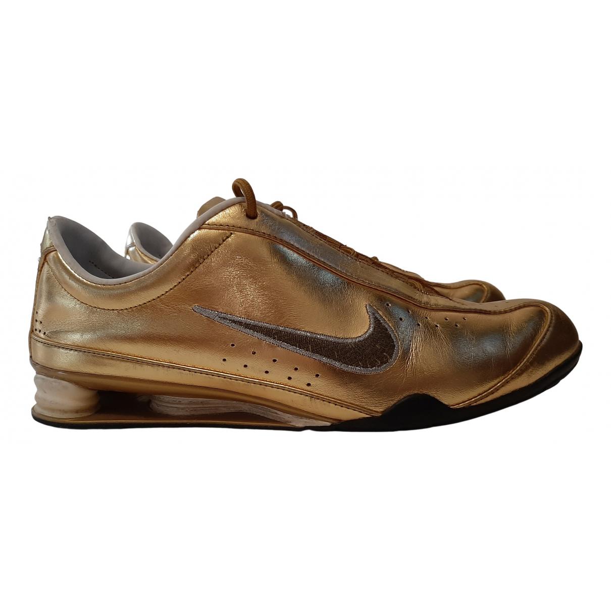Nike - Baskets Shox pour femme en cuir - metallise