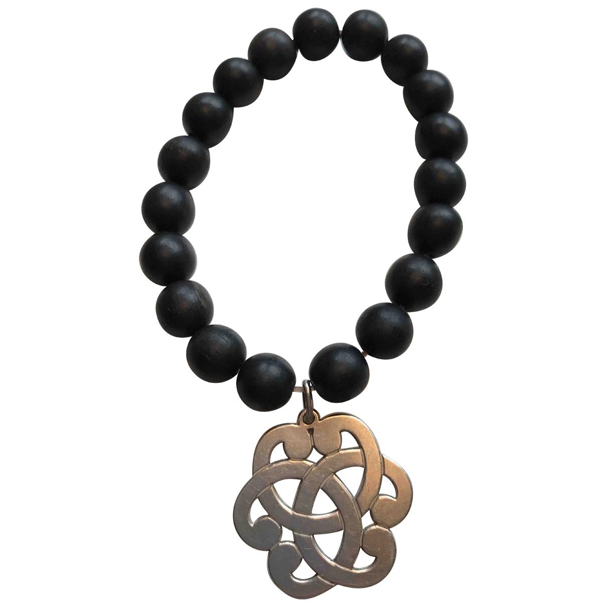 - Bracelet   pour femme en metal - noir