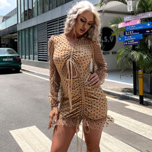 vestido con malla de lunares con abertura con nudo con cordon