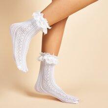 Socken mit Spitzen und Lochern Dekor