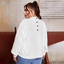 Texturierter Strick Pullover mit sehr tief angesetzter Schulterpartieund Knopfen hinten