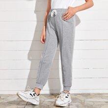 Pantalones deportivos con costura delantera de cintura con nudo