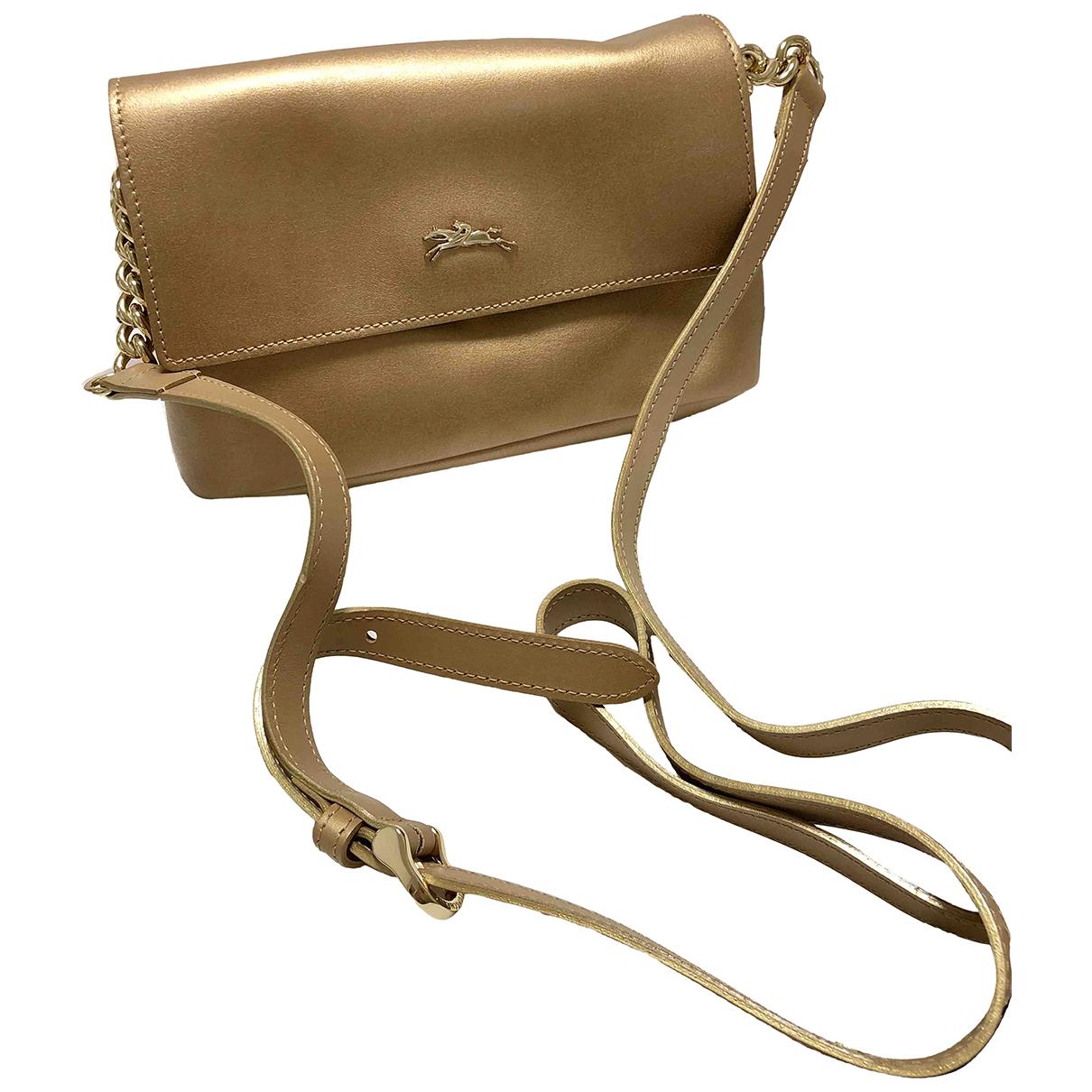Longchamp \N Gold Leather handbag for Women \N
