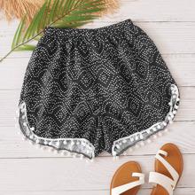 Shorts bajo con pompon de lunares