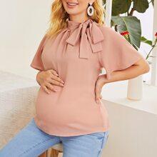 Maternidad top unicolor de manga raglan de cuello con cordon