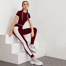 Conjunto top corto de dos colores con leggings con costura lateral en contraste