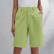 Shorts bermuda con bolsillo oblicuo unicolor
