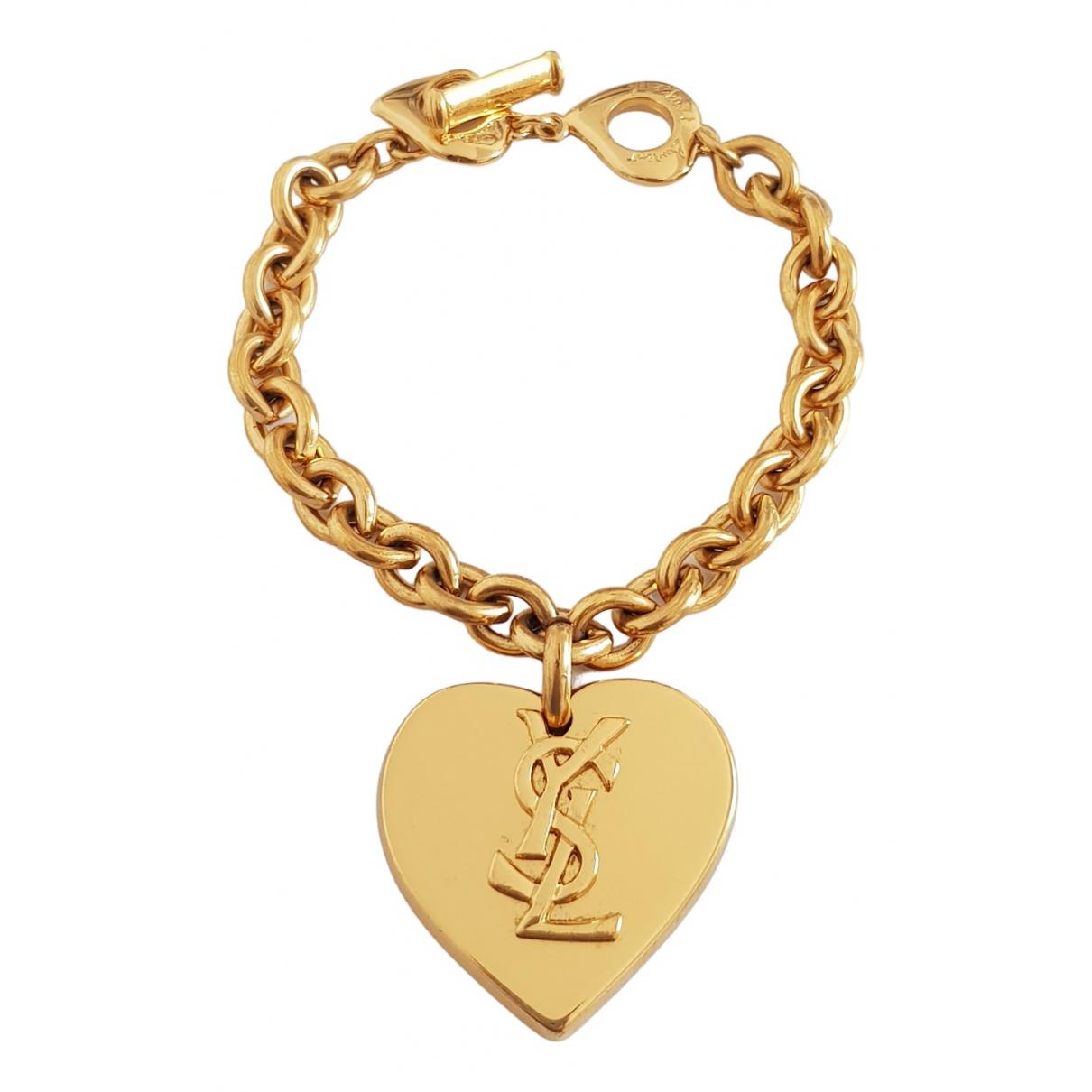 Yves Saint Laurent - Bracelet   pour femme en metal - dore
