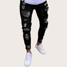 Maenner Jeans mit Grafik Flicken und Rissen